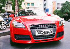 convertible(0.0), automobile(1.0), automotive exterior(1.0), audi(1.0), wheel(1.0), vehicle(1.0), automotive design(1.0), rim(1.0), audi tt(1.0), bumper(1.0), land vehicle(1.0), luxury vehicle(1.0), supercar(1.0),