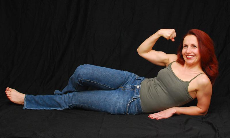 Mature lady bicep flex