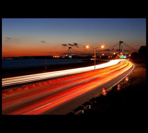 city nyc newyorkcity longexposure bridge bw ny newyork water canon landscape 2470mml glow traffic sundown gothamist dslr cp polarizer verrazanobridge gawker i♥ny circularpolarizer traffictrails verrazanonarrowsbridge verrazano 2470mm 2470mmf28 xti ef2470mm 400d bwcircularpolarizer i♥newyork nrbelex