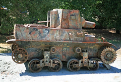 armored car(0.0), locomotive(0.0), churchill tank(0.0), military(0.0), combat vehicle(1.0), military vehicle(1.0), weapon(1.0), vehicle(1.0), tank(1.0), self-propelled artillery(1.0), cannon(1.0), land vehicle(1.0),