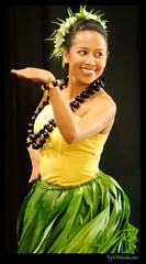 sports(0.0), team sport(0.0), yellow(1.0), event(1.0), performing arts(1.0), entertainment(1.0), dancer(1.0), dance(1.0), hula(1.0),
