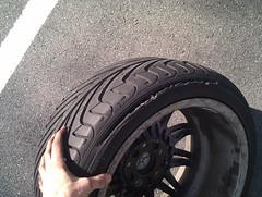 automotive exterior(0.0), bumper(0.0), tire(1.0), automotive tire(1.0), wheel(1.0), synthetic rubber(1.0), tread(1.0), rim(1.0), formula one tyres(1.0), alloy wheel(1.0), spoke(1.0),