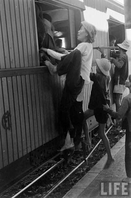 76 Hanoi residents climbing into train to flee south after Communist takeover 1954