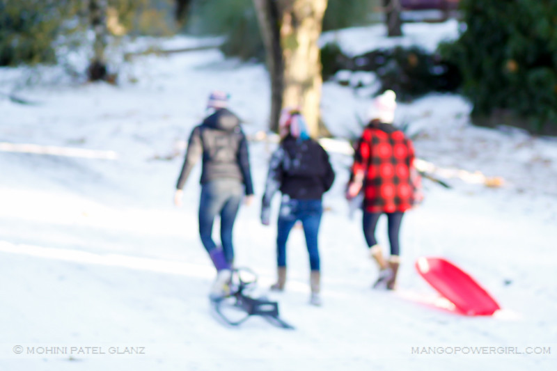 sledding girls go back up