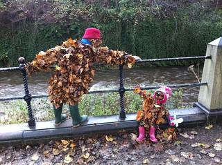 Leaf figures inspecting Gormley in Stockbridge, Edinburgh