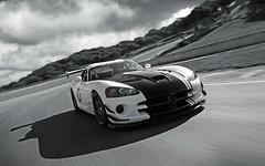 muscle car(0.0), race car(1.0), automobile(1.0), automotive exterior(1.0), wheel(1.0), vehicle(1.0), automotive design(1.0), land vehicle(1.0), srt viper(1.0), supercar(1.0), sports car(1.0),