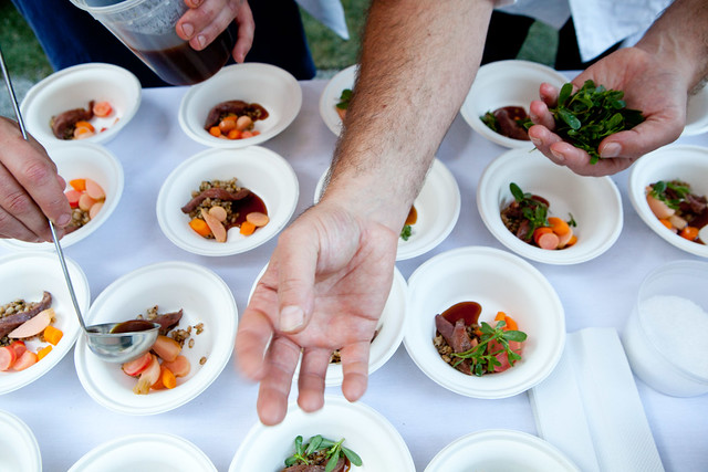Playful hand wave while plating