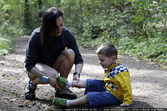 removing gravel from her grandson's shoe