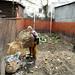 Seorang nenek membuang sampah. : An old woman disposes of rubbish. Photo by Ardian