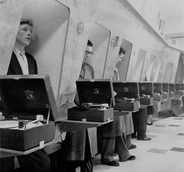 hmv 363 Oxford Street, London - Customers using listening booths 1950s