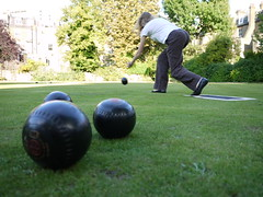 pocket billiards(0.0), boules(1.0), lawn game(1.0), individual sports(1.0), play(1.0), sports(1.0), recreation(1.0), outdoor recreation(1.0), player(1.0), lawn(1.0), bowls(1.0), ball(1.0),