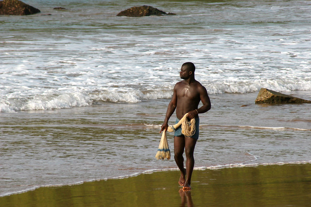 A local fisherman on the beach in Ghana.