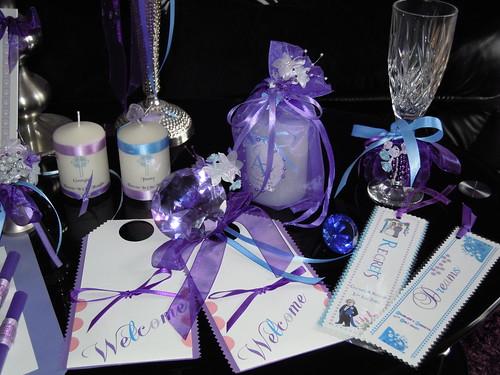 Purple Wedding Table Favors Centerpieces Programs photo by Salicia