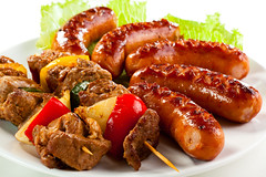 Beef shish kebabs and grilled sausages