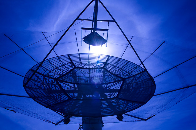 The Los Alamos Portable Pulser produces a Radio Frequency (RF) signal that mimics what would come from a weapon. The signal, broadcast into space through this dish antenna located near LANL's Physics Building, is used to calibrate sensors on orbiting satellites.  Photo by LeRoy Sanchez.