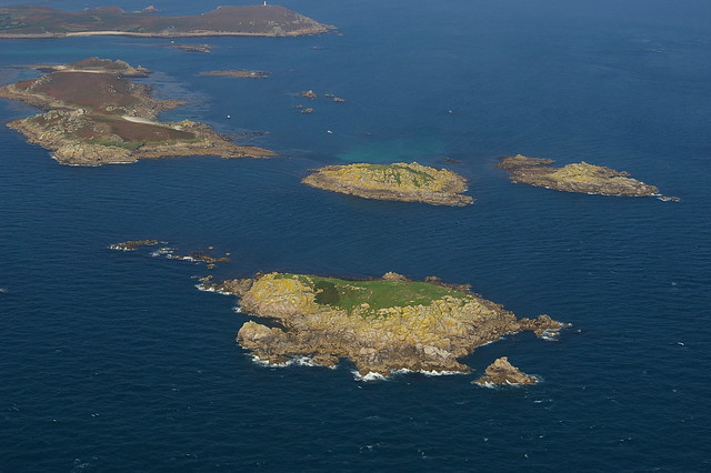 Aerial shot of uninhabited Scilly Isles as seen from helicopter
