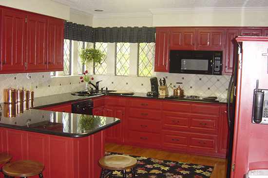 red cabinets, new back splash, new microwave