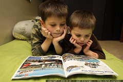 brothers poring over a lego catalog that arrived in …