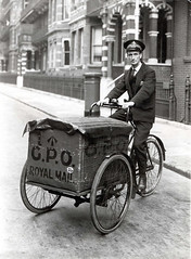 Postman on tricycle