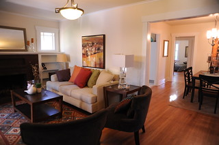 Living room; sofa, chairs table, lamps, painting, dining room, hallway, staged house, U District, Seattle, Washington, USA