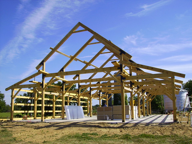 The timber frame awaiting coverings flickr photo sharing for Post and beam barn plans free