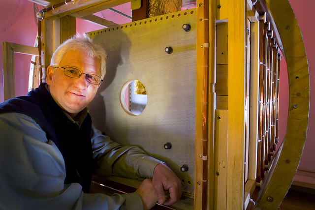 Andrei Matlashov, a member of the SQUID team at Los Alamos National Laboratory (LANL), with the apparatus used to study MRI at ultralow magnetic fields. The copper coils that produce the magnetic fields are wound on wooden armatures to avoid the magnetic distortions caused by metal.   Photo by LeRoy Sanchez.