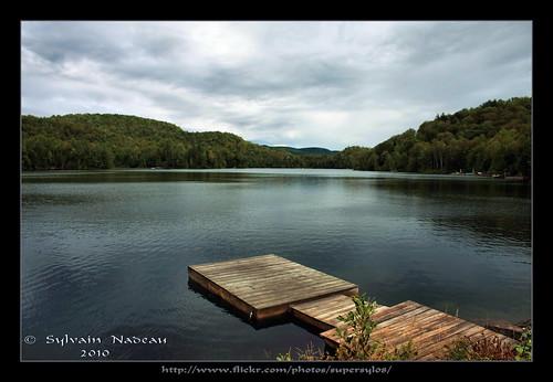 autumn trees sky lake mountains fall leaves clouds automne boat fallcolors lac ciel arbres nuages bateau laurentians feuilles montagnes laurentides couleursdautomne lacdespins