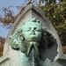 Child angel face - verdigris metal ornament on grave monument by Monceau