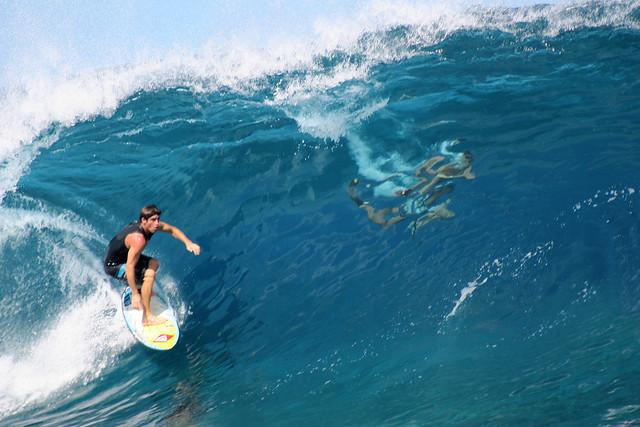 Surf those waves at Teahupoo, Tahiti.