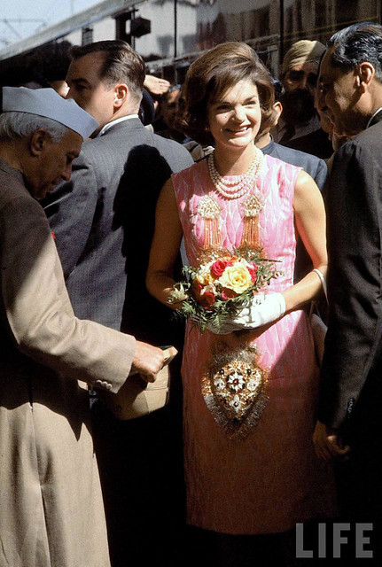 First Lady Jacqueline Kennedy wearing pink dress and three-stranded pearls during visit w. Indian leader Jawaharlal Nehru (L) & Ambassador to US B.K. Nehru. 3-1962