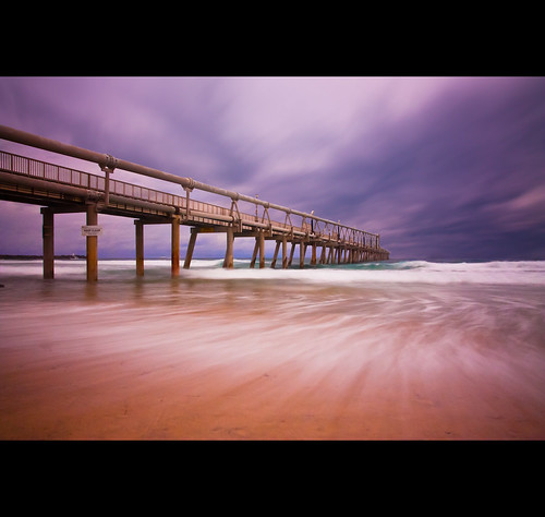 blue sea sky cloud beach water gold coast pier seaside movement sand long exposure walk surfer board wave brisbane
