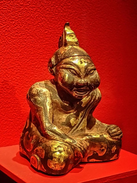 Mat weight depicting a figure listening to music Xuyi, Jiangsu China Western Han Period 2nd century BCE Bronze with inlaid gold and silver