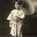 Child with fan and parasol