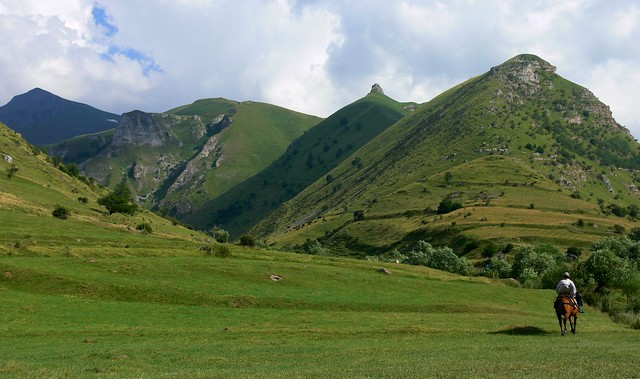 Horserider at Šar mountains (Шар-планина, Malet e Sharrit); Mt. Papka in the middle