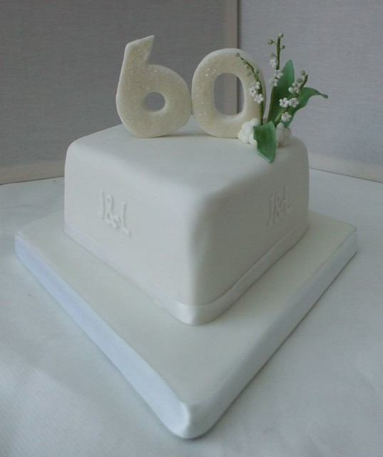 A 60th Wedding Anniversary Cake with Lily of the Valley as that is what