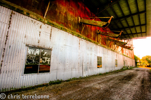 old sunset rural louisiana colorful decay farm manufacturing