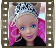 ear(0.0), pattern(1.0), face(1.0), purple(1.0), violet(1.0), head(1.0), pink(1.0), doll(1.0), barbie(1.0), eye(1.0), toy(1.0),