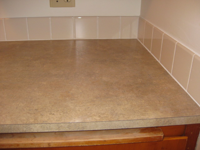 new laminate counters and tile backsplash in kitchen