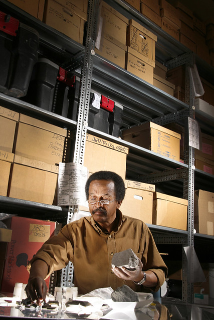 "Ethiopian-born geologist Giday WoldeGabriel is a staff member at Los Alamos National Laboratory (LANL), and co-leader and lead geologist of the world-renowned international Middle Awash paleoanthropological research team. He annually takes his skills to Ethiopia's Afar Rift, where he leads his team to some of the world's most exciting hominid finds, including the nearly complete skeleton of an ancient lady named ""Ardi,"" Ardipithecus ramidus.   Photo by LeRoy Sanchez."