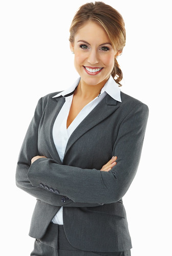 Smiling confident business woman isolated against white