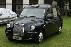 austin fx4(0.0), minivan(0.0), compact sport utility vehicle(0.0), automobile(1.0), automotive exterior(1.0), vehicle(1.0), city car(1.0), compact car(1.0), tx4(1.0), sedan(1.0), land vehicle(1.0), luxury vehicle(1.0),