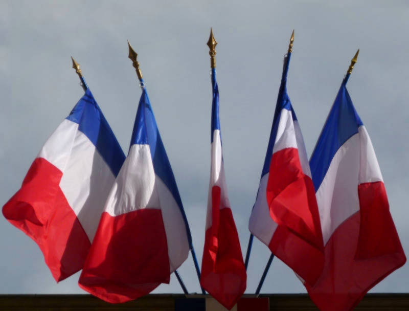 Multiple French flags as commonly flown from public buildings