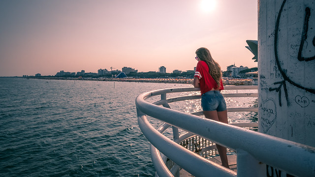 The girl in red - Lignano sabbiadoro, Italy - Color street photography
