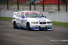 race car, auto racing, automobile, bmw, touring car racing, racing, sport venue, vehicle, stock car racing, sports, performance car, automotive design, motorsport, rallycross, touring car, sedan, race track, land vehicle, luxury vehicle, sports car,
