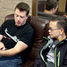 John Bristowe and Phil Wu playing with a Windows Phone 7 by Morten Rand-Hendriksen