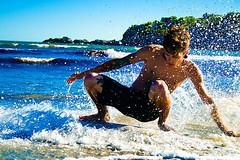 beach(0.0), swimming(0.0), boardsport(1.0), sports(1.0), sea(1.0), surfing(1.0), ocean(1.0), wind wave(1.0), wave(1.0), vacation(1.0), water sport(1.0), skimboarding(1.0), coast(1.0), surfboard(1.0),