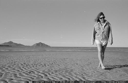 laura pappas walks across the beach in san felipe, baja california, mexico   scan 1990 04 mx baja san felipe spring break 0003