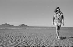 laura pappas walks across the beach in san felipe, b…