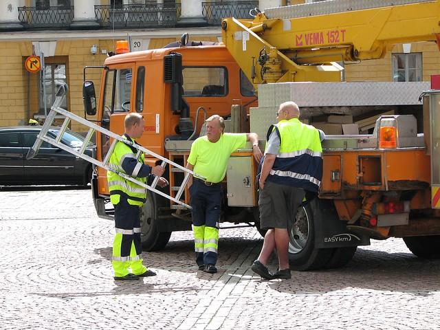 Tres trabajadores finlandeses.