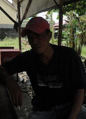 """Pedagang HIK, 40, """"Saya ingin banyak lapangan pekerjaan tersedia di Karangasem."""" : Traditional Food Vendor, 40, """"I want more job opportunities available in Karangasem."""""""